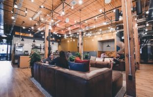 A coworking space with fairy lights,