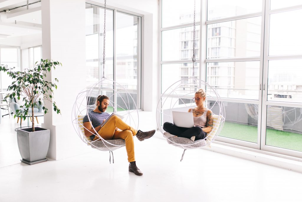 Two people working from a coworking space.