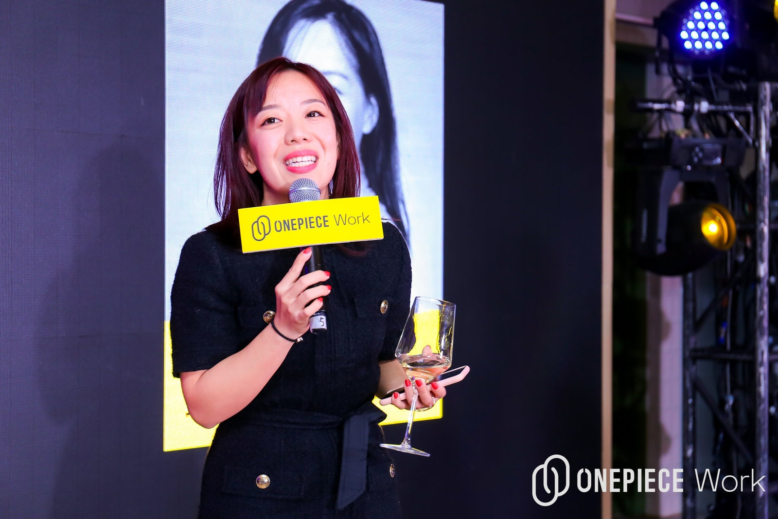 A coworking founder, Vickey Li, speaking at a coworking event.