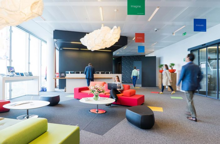 A coworking space with colorful couches.